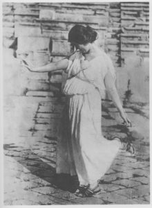 Isadora Duncan posing at the Temple of Dionysus