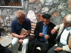 Mark Janse and two men in Greece